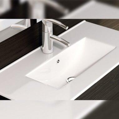 Lavabo cerámico fondo reducido sobre mueble