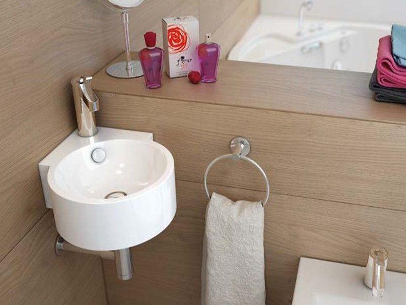 Lavabo esquinero para baño pequeño